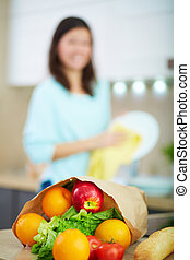 Lunchbag - Vertical image of paperbag full of fruits and...