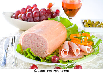 Luncheon meat, salad, olives