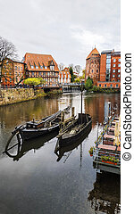 Luneburg, Germany - November 02, 2019: Old boat on the river bank in Luneburg