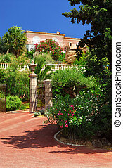 Lush garden in front of a villa