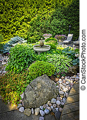 Lush landscaped garden - Lush perennial garden with fountain...