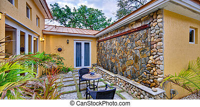 Lush landscaped patio - View of a lush landscaped patio in a...