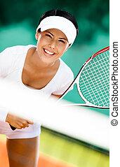 lustig, frau, in, sportkleidung, spielen tennis