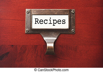 Lustrous Wooden Cabinet with Recipes File Label in Dramatic...