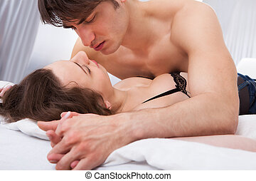 Lusty Couple In Bed - Lusty young couple having prelude in...