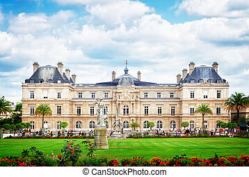Luxembourg garden with green lawn at summer day, Paris, France, retro toned