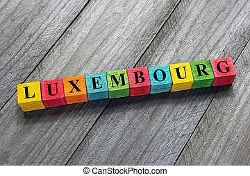 Luxembourg word on colorful wooden cubes