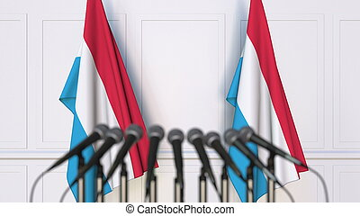 Luxembourgian official press conference. Flags of Luxembourg...