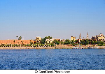 luxor town from the nil river - luxor town from the boat on ...