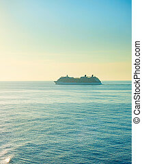 Luxur sea cruise - Cruise liner at sunset. Sun in the sky