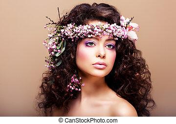 Luxuriant. Femininity. Fashion Model with Classic Wreath of Flowers