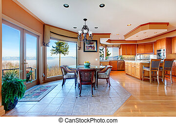 Luxuriant round kitchen room and dining area with walkout...