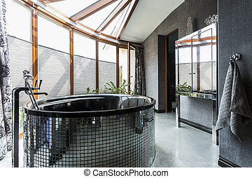 Luxurious bathroom with freestanding glossy bathtub -...
