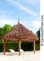 Luxurious beach hut. - Beach hut wiht deck chairs on white...