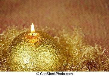 luxurious golden burning candle