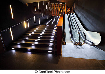 Luxurious interior from modern materials with  stair and escalator