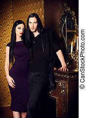 luxurious lifestyle - Glamorous couple in elegant evening...