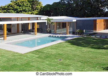 Luxurious mansion - Modern backyard with swimming pool in ...
