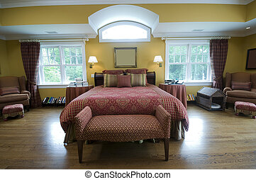 luxurious master bedroom with king size bed and beautiful window light