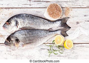 Luxurious mediterranean seafood background. - Two fresh sea...