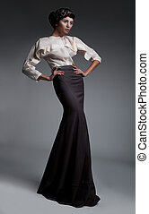 Luxurious noblewoman brunette in retro clothes studio shot -...