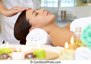 Luxurious procedure - Portrait of young female enjoying the ...