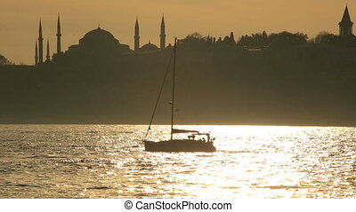 luxurious sail ship passing Bosporus, silhouette Hagia...