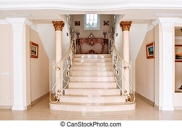 Luxurious staircase with marble steps and decorative and...
