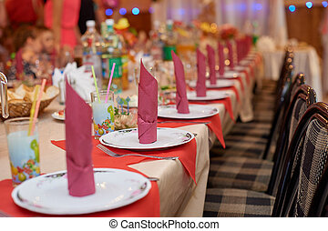 luxurious table setting at a restaurant for a wedding dinner
