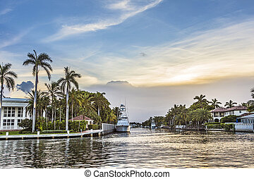 luxurious waterfront homes and yachts at the canal in Fort...