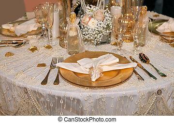 Luxurious wedding dinner with golden theme