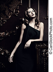luxurious woman - Beautiful young woman wearing black...