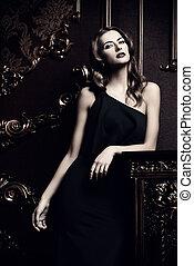 luxurious woman - Beautiful young woman wearing black...
