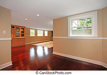 Luxury basement with cherry hardwood and kitchen