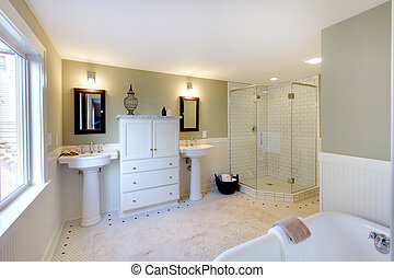 Luxury bathroom with iron tub and walk-in shower and double sinks.