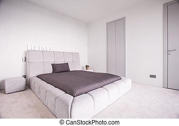 Luxury bed in exclusive bedroom