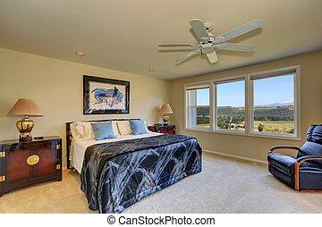 Luxury bedroom interior in creamy and dark blue tones