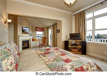 Luxury bedroom with carpet and quilt bedding.