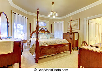Luxury bedroom with high pole carved wood bed, nightstand and vanity cabinet