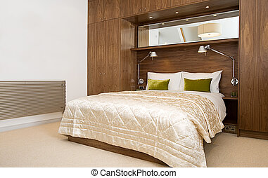 Luxury Bedroom with Walnut Wardrobes - Shot of a Luxury...
