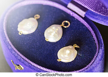 luxury big pearls in a purple and blue jewelry case.