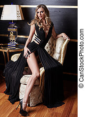 Luxury blond woman in a black dress.