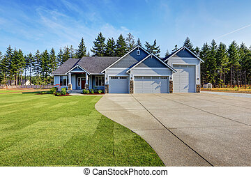 Luxury blue house with curb appeal. Three car garage.