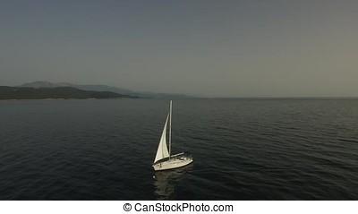 luxury boat traveling on sea aerial view. Footage. Aerial...