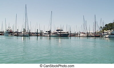 Luxury boats docked in a pier - A long moving shot in the...