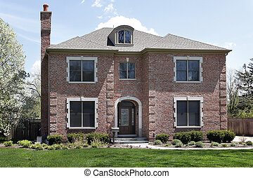 Luxury brick home with arched entry
