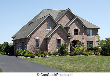 Luxury brick home with cedar shake roof - Luxury brick home...