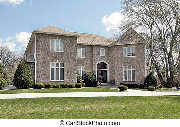 Luxury brick home in suburbs with side garage