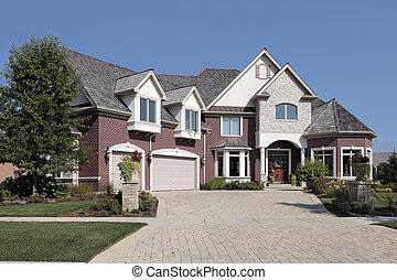 Luxury brick home with stone pillars