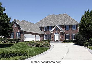 Luxury brick home with three car garage